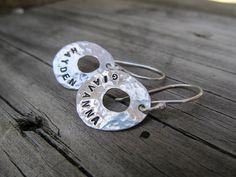 Personalized earrings, names dates, inspirational words, hand stamped for you on sterling silver hand cut discs $42. by JoDeneMoneuseJewelry