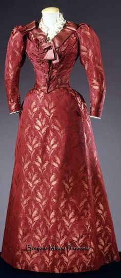 Dress, Atelier Mlle Rebatter Robes, Valence, France (attribution now removed from Europeana site), ca. 1890. Diagonally cut russet silk damask in tulip pattern, lace, & ivory satin ribbon. Costume Gallery of the Pitti Palace via Europeana Fashion