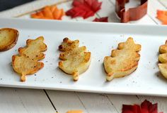 use leaf-shaped cookie cutters on slices of potatoes.  Would be pretty with sweet potatoes and butternut squash too!
