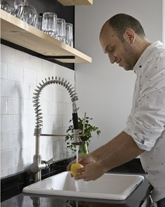 """Mark out a work triangle for a functional flow around the kitchen. """"When planning a kitchen, it's important to mark out your work triangle: you need food storage, a washing/preparing station and the main cooking area to form a triangle,"""" says Libertad. """"In our home this means the fridge and sink are next to each other, and opposite the oven. This layout creates a smooth flow of activities and minimizes mess."""""""