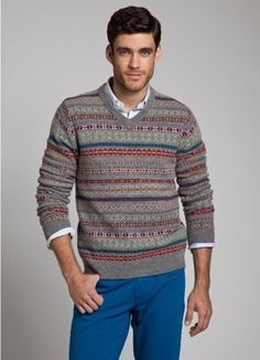 Shop this look on Lookastic:  http://lookastic.com/men/looks/grey-v-neck-sweater-and-blue-longsleeve-shirt-and-blue-chinos/151  — Grey Fair Isle V-neck Sweater  — Blue Long Sleeve Shirt  — Blue Chinos