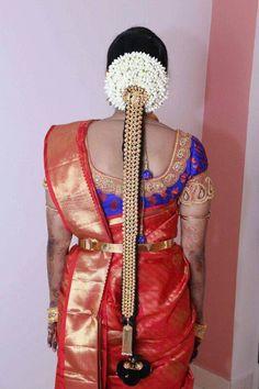 South Indian bride. Temple jewelry. Jhumkis.Red silk kanchipuram sari with contrast blue blouse.Braid with fresh flowers. Tamil bride. Telugu bride. Kannada bride. Hindu bride. Malayalee bride.Kerala bride.
