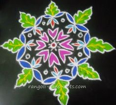 free hand rangoli - a simple design with floral petals  and leaves for Diwali
