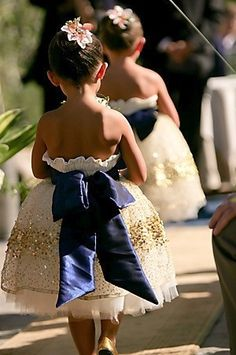 love the poofy flower girl dress and huge bow! bow to match bridesmaids' dresses