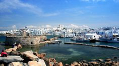 The rocks offer travelers a perch for a panoramic view of Naoussa Harbor.