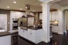 Clara Barton kitchen, white on white shaker cabinets, black stained wood flooring, stainless Monogram appliances.