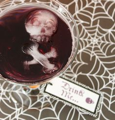 halloween drinks - Love the idea of using the Bone Chillers ice cube tray, allowing everyone to have a skull and crossbones floating in their drink! :)