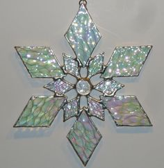 stained glass snowflake suncatcher design by bitsandglassart Stained Glass Angel, Stained Glass Ornaments, Stained Glass Christmas, Stained Glass Suncatchers, Faux Stained Glass, Stained Glass Designs, Stained Glass Projects, Stained Glass Patterns, Leaded Glass