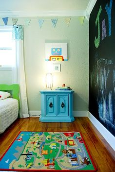 Love the idea of the chalk board wall; as long as they understand it's only THAT wall they can color on...