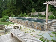 Image result for above ground pool ideas with stone patio