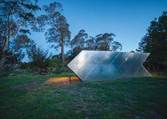 Small arrow-shaped art gallery installed in an Australian garden