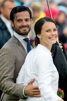 The couple couldn't stop grinning while attending Victoria Day celebrations in Sweden in July 2014.