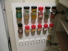 """Spice clips for inside cupboard doors.... Think I'll get these and put 'em on the wall inside my """"pantry"""" here in my teeeeeny tiny kitchen."""