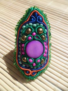 Handmade, soutache ring. Purple, green, blue, orange, pink, gold.