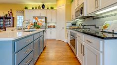 Cook your favorite #family #recipes in this spacious #gourmet #kitchen with #black #granite #counters and #white #pastel #cabinetry. #woodfloor #pantry #organization
