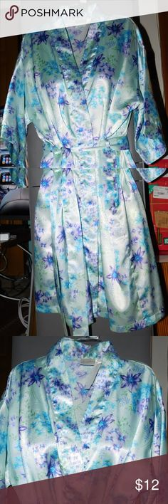 Secret Treasures Robe Size Small This robe has 1/2 sleeves, inner and outer ties.  Pre-owned in very good condition. Size small: bust 32-34, waist 25-27, hips 34-36, equivalent dress size 2-6. Color blue with purple/green floral print. 100% polyester item #371217 Secret Treasures Intimates & Sleepwear Robes