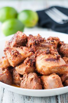 Portuguese Marinated Pork (Torresmos de Vinha d'Alhos). This is a very popular and traditional dish in various regions of Portugal; more so in the Azores and Madeira islands. This wine and garlic marinated pork recipe is amazing! Find it on the blog now.