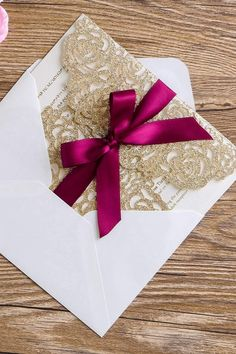This amazing elegant design of Gold Glitter Wedding Invitations Cards Kit features a  Laser Cut Hollow Rose of a Gold Sparkle paper, comse with a Inner Sheet of Shiny Ivory Pearl Hard Papers that looks extremely luxurious, and Burgundy Ribbons. Perfect idea for gold luxury themed weddings.
