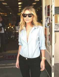 simple style. Classic button and black jeans.  Ashley Olsen.