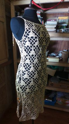 Free pattern for crochet lace dress or overdress. Instructions include modifications to make a shorter dress, a longer dress and a top.