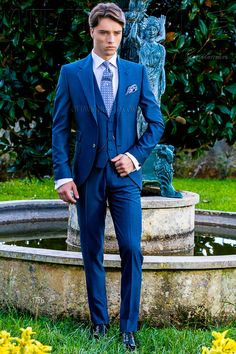 Italian bespoke royal blue suit with wide notch lapels, 2 mother of pearl  buttons, ticket pocket and double vent.