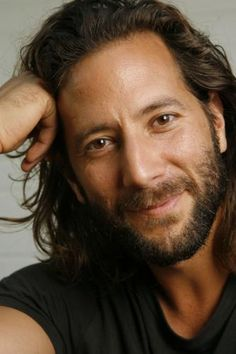 Henry Ian Cusick.  I don't know about any of you people, but I wouldn't mind getting LOST on a deserted island with this hottie!
