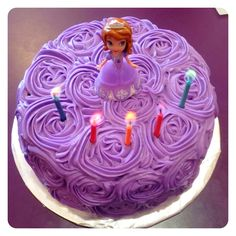 Purple frosting with sofia doll on top - maybe add little white pearl candies