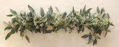 This is a great fresh floral centerpiece for any table! We handcraft these to look there absolute best in your home! This garland features babys breath