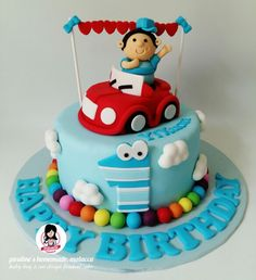 Baby boy and car design fondant cake