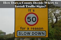 How does a county decide where to install traffic signs?