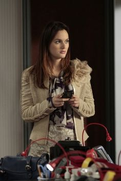 Blair having a Carrie moment with a flower brooch