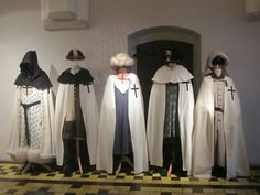 Clothing of Teutonic knights on display in the Castle of the Teutonic Order in Malbork, Poland