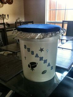 Cheerleading Buckets with a cushioned seat lid.