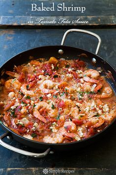 Quick and easy, shrimp baked in a tomato sauce with onions, garlic, parsley, dill, and feta cheese. On SimplyRecipes.com