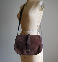 vintage 1980s fudge brown large saddle bag / suede leather bag by AdrianAndOlgaCompany on Etsy https://www.etsy.com/listing/255270733/vintage-1980s-fudge-brown-large-saddle