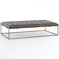 """Chic style meets inviting comfort with the Linton coffee table. A blind-tufted, top-grain leather cushion in Ebony upholstery floats effortlessly on an antique brass base with cage-like detailing. Available in Small, Large, and Square; Top-grain leather cushion; Small: 50""""W x 32""""D x 16.25""""H; Large: 63""""W x 35.5""""D x 16.25""""H; Square: 36""""W x 36""""D x 16.25""""H"""