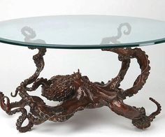 Give your land-lover home a nautical touch that draws the eyes in with the bronze octopus coffee table. This beautiful bronze cephalopod sprawls over the floor, creating the illusion it's on the move while three of its tentacles hold up the glass top.