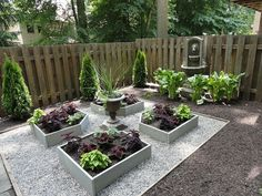 Maximize a small outdoor area by adding raised beds and a gurgling fountain.