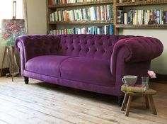 a purple leather sofa, worn and a tad beat up...this would be perfect in my master bedroom!
