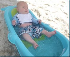so mad I didnt think of taking our tub to the beach! Good tips for taking a baby to the beach (or lake)
