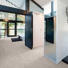 This modern house interior features brown sandstone effect matt porcelain floor tiles Large Floor Tiles, Tile Floor, Flooring Tiles, Sandstone Color, Porcelain Floor, Colour Board, Colorful Interiors, Interior And Exterior, New Homes