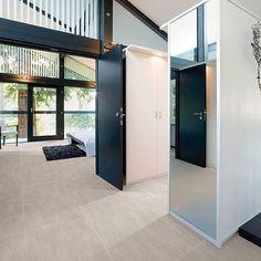 This modern house interior features brown sandstone effect matt porcelain floor tiles Large Floor Tiles, Tile Floor, Flooring Tiles, Sandstone Color, Porcelain Floor, Tiles Texture, Color Tile, Colorful Interiors, Interior And Exterior