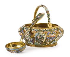 A Russian gilded silver and shaded enamel swing-handled sugar basket | Lot | Sotheby's