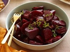 Roasted Beets : For a beautiful jewel-toned side to add to the Thanksgiving table, Ina dresses tender roasted beets in a sweet-tangy dressing made of raspberry vinegar and orange juice.