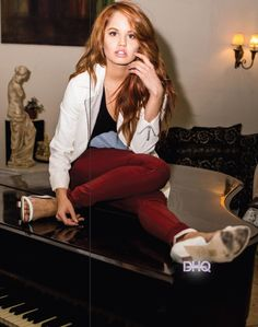 Debby Ryan sitting on a piano for NKD magazine.