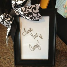 Picture frame with paper inside, use dry erase marker to leave notes!