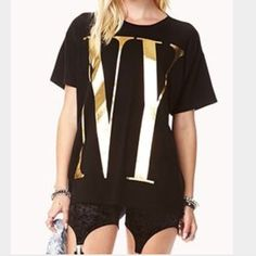 "LA | NY Graphic T-shirt Black T-shirt with gold-tone foil text graphic that reads NY at front and LA at back. Measures approx. 26"" length (flat). 60%cotton/40% modal. Condition: gently used, wrinkled due to storage. *due to manufacturer stamp methods, foil has slight imperfections. Price reflects. Sold AS IS. Final Sale.   ❌NO TRADES ❌No Offsite Transactions  ✅All Price Negotiations are handled strictly through the OFFER Feature Only. Lowball offers will be ignored ✅BUNDLE TO SAVE! Forever…"