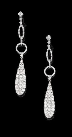 A pair of diamond pendent earrings Each pear-shaped plaque, suspended from an openwork surmount, set throughout with brilliant-cut diamonds