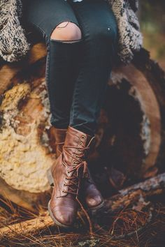 Brown lace up boots and black ripped knee skinny denim