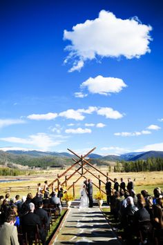 Colorado Rockies rustic outdoor ceremony (photo: Two One Photography)
